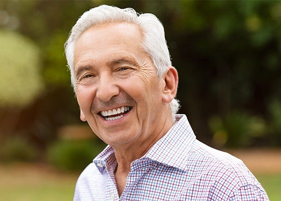 older man smiling bright