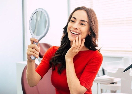 woman in red smiling in mirror