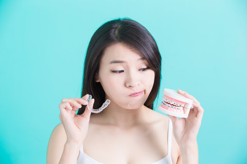 girl deciding between Invisalign and braces