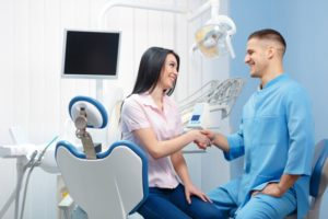 woman learning about cosmetic dental treatments in Annapolis