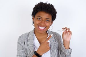 woman smiling with Invisalign after braces in Annapolis